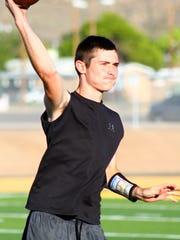 Alamogordo senior Kyle Hooper throws a pass during a workout Thursday evening at Tiger Stadium.