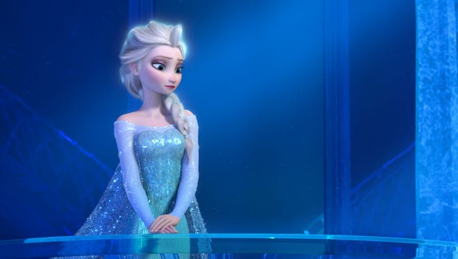 """Teenage Elsa the Snow Queen, voiced by Maia Mitchell, in a scene from the animated feature """"Frozen."""""""