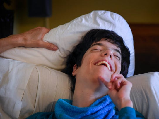 Samantha Campbell, 29 years old, laughs as she snuggles