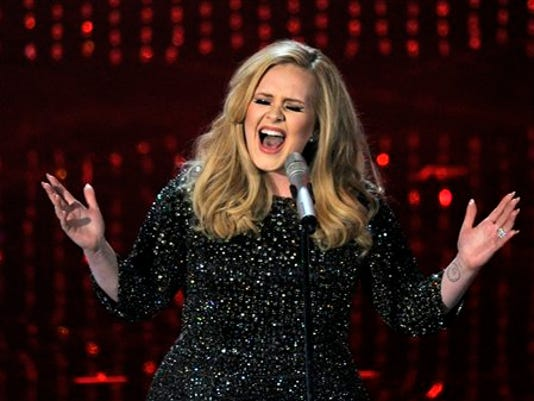 Singer Adele performs during the Oscars at the Dolby Theatre on Sunday Feb. 24, 2013, in Los Angeles.