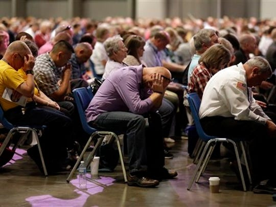 People pray during the annual meeting of the Southern Baptist Convention on June 14, 2016, in St. Louis.
