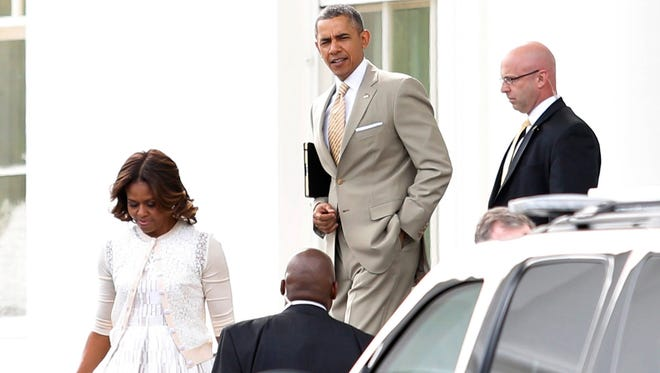 President Obama and first lady Michelle Obama en route to church services.