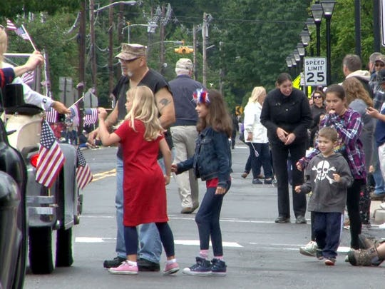 People line Main Street during the 44th Anuual Farmingdale Memorial Day Parade Monday, May 29, 2017.