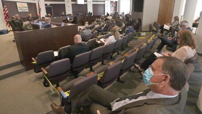 Volusia county council gets back to business with most attendees wearing face masks and keeping social distancing, Tuesday May 19, 2020.