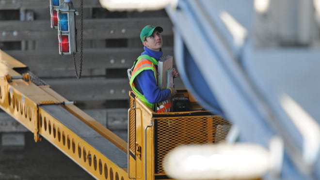 Engineer Tim Borowski examines the underside of the Walnut Street Bridge as the Wisconsin Department of Transportation performs an annual inspection on April 4, 2012.