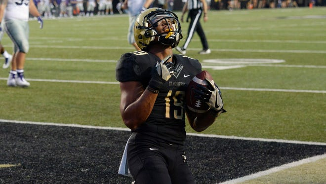 Vanderbilt wide receiver C.J. Duncan (19) kneels in the end zone after scoring a touchdown on a 3-yard pass reception against Kansas State the in the first half of an NCAA college football game, in Nashville, Tenn.