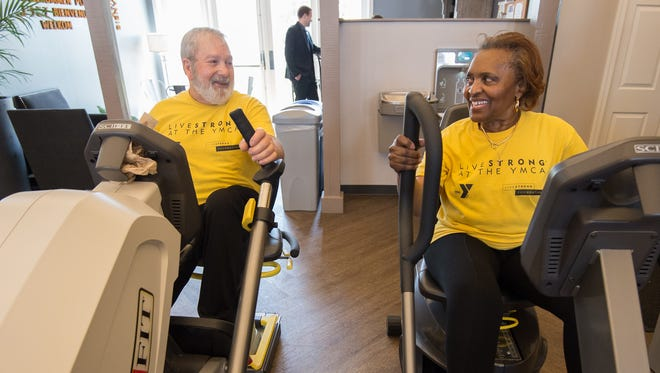 Glenn Phillippi of Townsend and Claire Johnson of Middletown have a conversation during their LIVESTRONG at the YMCA workout.