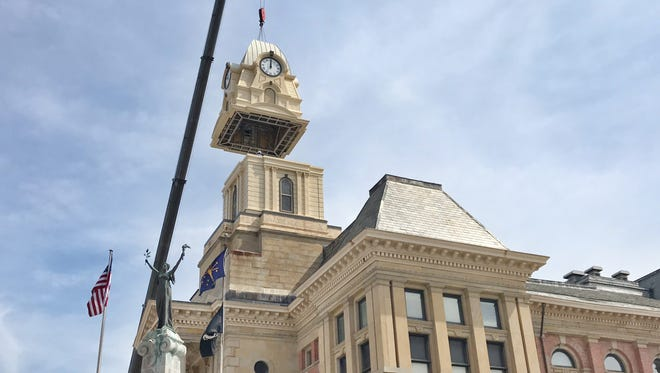 A crane lifts one piece of a new clock tower into place at the Montgomery County Courthouse in Crawfordsville on Thursday.