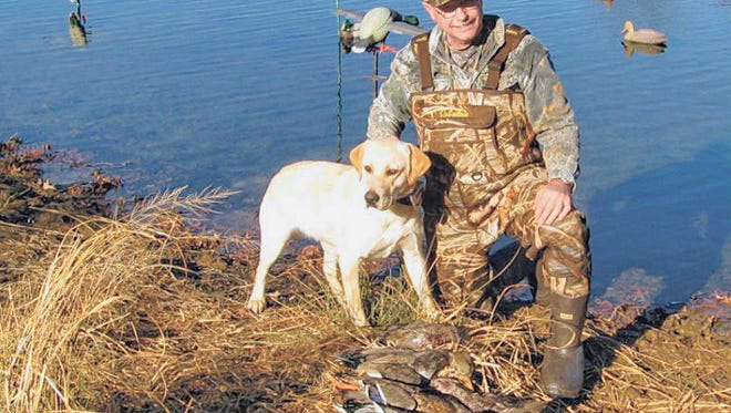 John Farris, Carl Junction, and his yellow retriever, with a mixture of mallards, widgeons and gadwalls taken in the south zone by Farris and Leon Waggoner