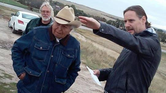 Director Steven Lewis Simpson (right) sets up an upcoming scene with his star, 95-year-old Dave Bald Eagle.