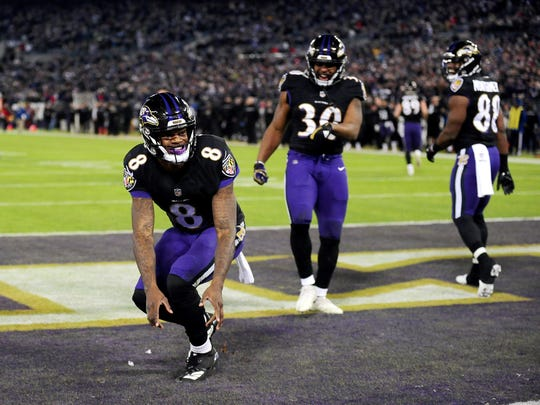 Dec 30, 2018; Baltimore, MD, USA; Baltimore Ravens quarterback Lamar Jackson (8) celebrates after scoring a touchdown in the second quarter against the Cleveland Browns at M&T Bank Stadium. Mandatory Credit: Evan Habeeb-USA TODAY Sports
