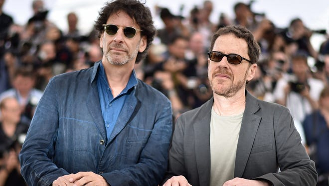 U.S. directors and presidents of the feature film jury Joel Coen, left, and Ethan Coen pose during a photocall ahead of the opening of the 68th Cannes Film Festival in Cannes, France.