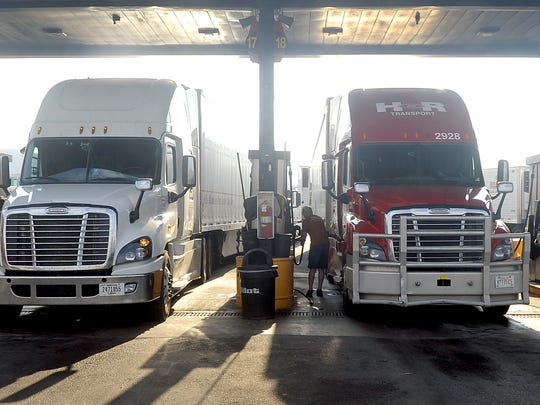 A trucker fuels up at the Pilot Travel Center in Fernley.