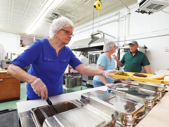 Volunteers Carol Cubbison, left, Barb Stoneburner and