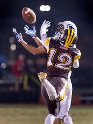 Central Valley Christian's Gavin Salierno takes pass