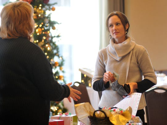 Shannon Schaefer of Wausau, right, shops during a Wausau Area Professional Women's networking and holiday luncheon in 2011 at the Jefferson Street Inn in downtown Wausau.