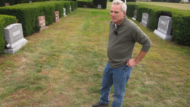 Carl Anderson of West Berkshire views traditional grave sites at Resurection Park in South Burlington in late September