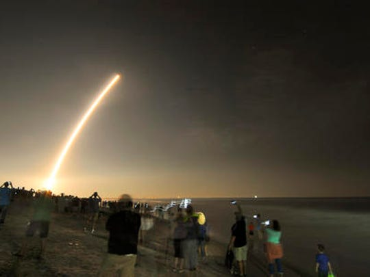 Cell phones light up the beaches of Cape Canaveral and Cocoa Beach, Fla., north of the Cocoa Beach Pier as spectators watch the launch of the NOAA GOES-R weather satellite, Saturday, Nov. 19, 2016. It was launched from Launch Complex 41 at Cape Canaveral Air Force Station on a ULA Atlas V rocket.