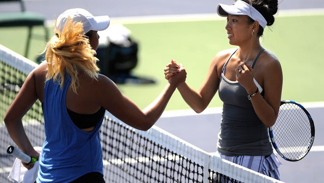 Chelsea Kung (right) is congratulated by her opponent, Isabella DiLaura, from Austin, after Kung won the girls' 18 singles championship match of the USTA Texas Grand Slam on Friday, June 16, 2017, at Abilene Christian Unversity's Eager Tennis Center.