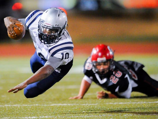 Reitz's Da'ziaun Sargent (10) dives at the end of a run past Harrison's Kavaughn Mathew (20) during the Class 4A Sectional 24 football championship game at Romain Stadium, Friday, Nov, 4, 2016.
