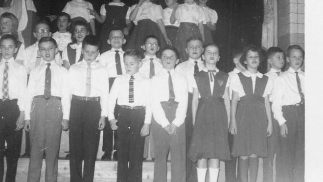 Students sing during a St. Mary's Prep Christmas concert in 1958, four years after the Catholic school's building was completed.