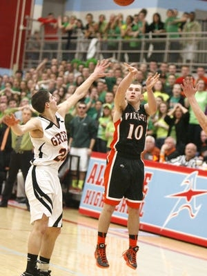 Hoover's Dom Iero (10) shoots a buzzer-beating 3-pointer to down Green in a 2013 district semifinal at Alliance High School.