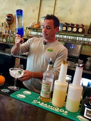 Nick Brittner, bartender at Tacos & Tequila Cantina in North Naples, makes the Maserita, among the most popular margaritas at the restaurant.