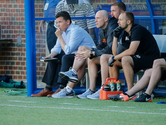 FC Cincinnati manager Alan Koch watches the game in