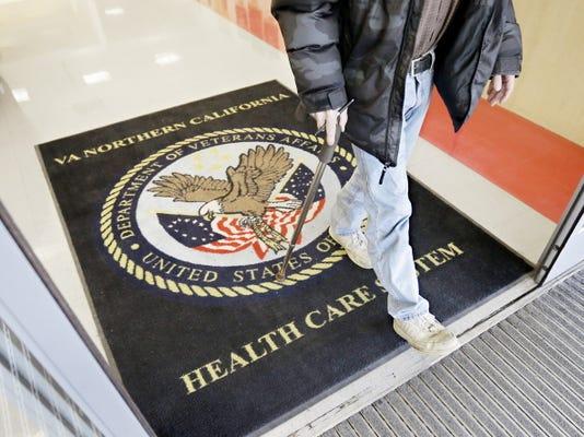 A visitor leaves the Sacramento Veterans Affairs Medical Center April 2 in Rancho Cordova, Calif.