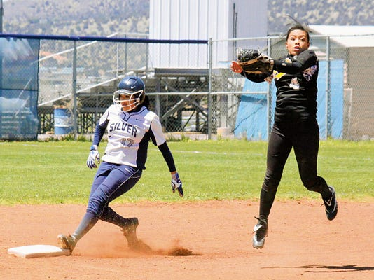 Danny Udero/Sun-News   Silver's Carolyn Castillo reaches second base safely during action against Kirltand Central on Saturday at the Ben Altamirano Sports Complex.