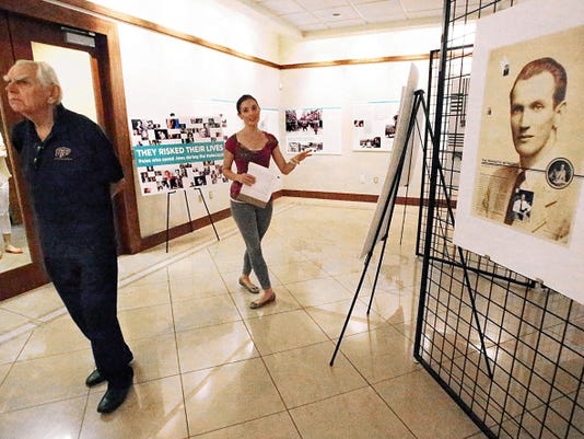 Z. Anthony Kruszewski, left, professor of political science at UTEP gets a preview of a new exhibit at the El Paso Holocaust Museum with Jamie Flores, education director at the museum Friday.