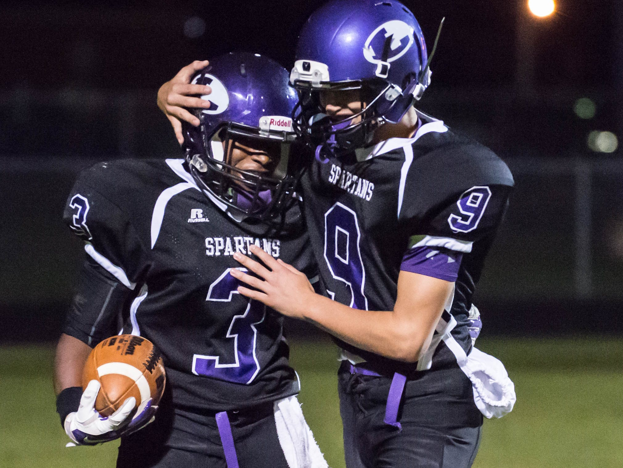 Lakeview's Connor Caswell (9) congratulates Jay'Vion Settles (3) after scoring Friday evening.