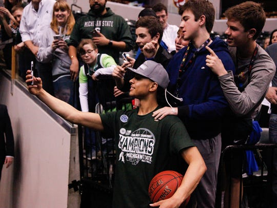 Bryn Forbes takes a selfie with fans after beating