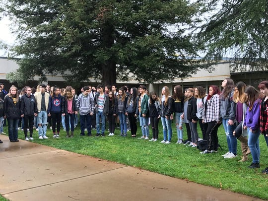 Enterprise High School students participate in Wednesday's national walkout to call for more gun control in the wake of the Feb. 14 shooting at a Parkland, Florida, high school.