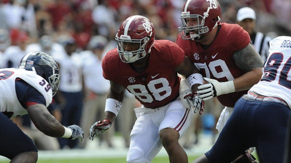 Alabama tight end O.J. Howard (88), an Autauga Academy standout, and offensive lineman Austin Shepherd (79) are looking to block a Florida-Atlantic player last Saturday at Bryant-Denny Stadium in Tuscaloosa.