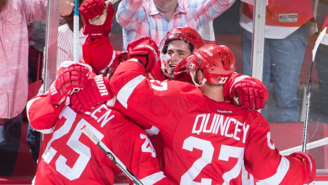 Rookie Dylan Larkin (facing forward) has 14 goals, and has helped keep the Red Wings in the playoff hunt through the first half of the season.