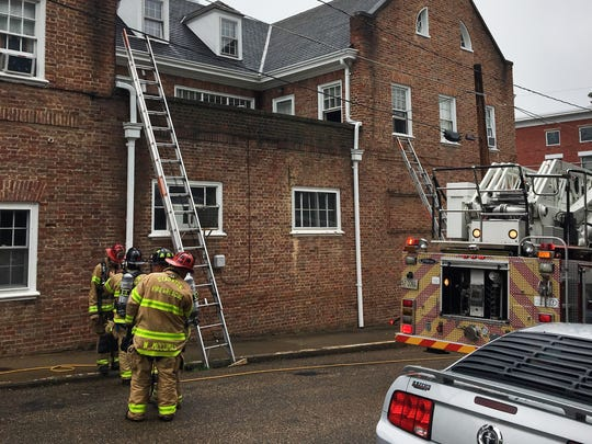 Smoky fire in an apartment downtown in Staunton forced residents out into the street.