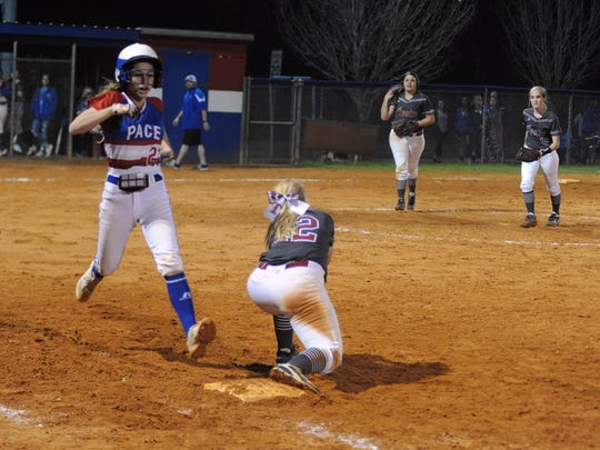 Pace's Kenna Coleman stretches for first base during