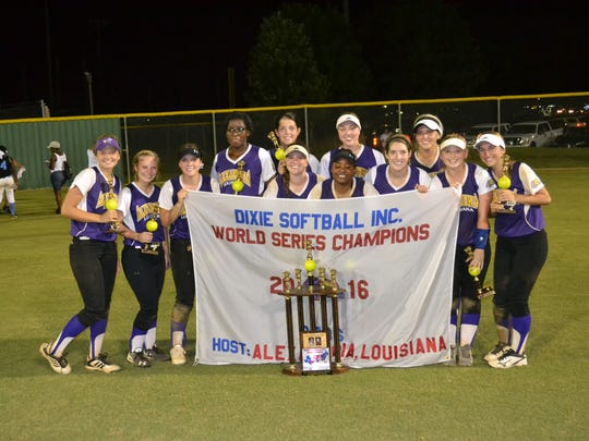 Alexandria Deb's pose with their championship trophy and team flag after defeating North Carolina 6-3 and 15-3 Wednesday night at Johnny Downs Sports Complex to win the Deb's Dixie World Series.
