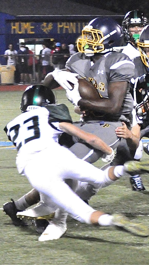 Yorktown's Reese Andrews (23) helps wrap up Panther
