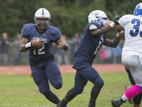 Mater Dei Prep quarterback George Pearson picks up yardage in the Seraphs' win over Shore, one of 12 straight wins they reeled off in winning their first-ever state sectional championship.