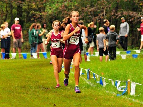 Chiles freshmen Olivia Miller (front) and Emily Culley head towards the finish at the Alligator Lake Invitational. Miller and Culley finished 59th and 60th as the fifth and sixth runners for the Timberwolves.