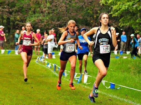 Chiles senior Emma Tucker stalks Columbia's Bridget Morse and Newberry's Maggie Rice on the way to the finish at the Alligator Lake Invitational in Lake City. Tucker edged out both at the finish line in 19:02 for her first win of the season.