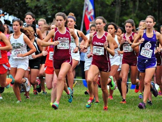 Chiles seniors Alexandra Wallace and Emma Tucker lead the Timberwolves off the starting line during Saturday's Alligator Lake Invitational in Lake City. Tucker won the race by a nose, while Wallace finished fourth.