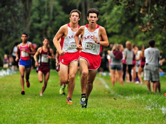 Leon's Matthew Cashin and Adam Wallenfelz make a dash for the finish during Saturday's race at Alligator Lake. Cashin and Wallenfelsz finished 2-4 for the Lions' second-place team.