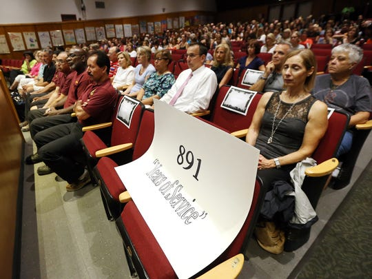 Thirty four Madison school district staffers (teachers, administrators and other employees) with more than 20 years in the district and a combined 891 years of service are honored at Madison High School on their first day back at school. September 1, 2016, Madison, NJ