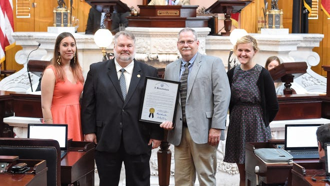 Little Buckeye Children's Museum intern Suzanna Hammond, Rep. Mark Romanchuk (R-Ontario), Little Buckeye Children's Museum executive director Fred Boll and museum associate Hannah Bloir, from left, display a resolution in the Ohio House Chamber on Wednesday, June 28, 2017. State lawmakers recognized Mansfield's Little Buckeye's Children Museum after it was named best museum in the state in April.