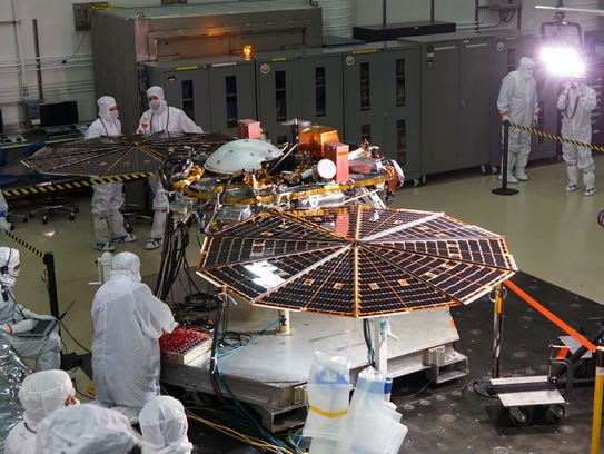 Worker in a clean room at the Lockheed Martin satellite
