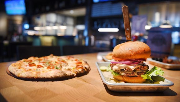 Chef Jesse Severs makes a Double Barrel Burger and De Giorgio pizza at the Barrel House restaurant Monday, April 2, in Sioux Falls.