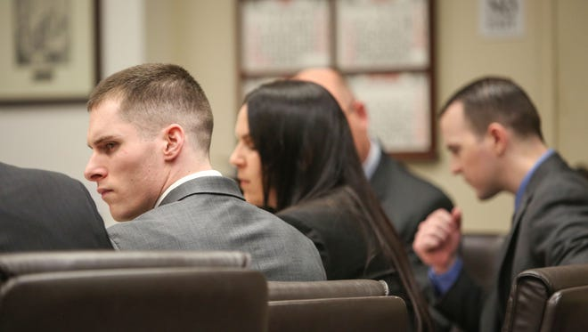 Cristin Smith, left, and Robert Pape, right, attend the hearing where the two men are accused of killing three people in Pinyon Pines in 2006.   The hearing was at the Riverside County Hall of Justice.